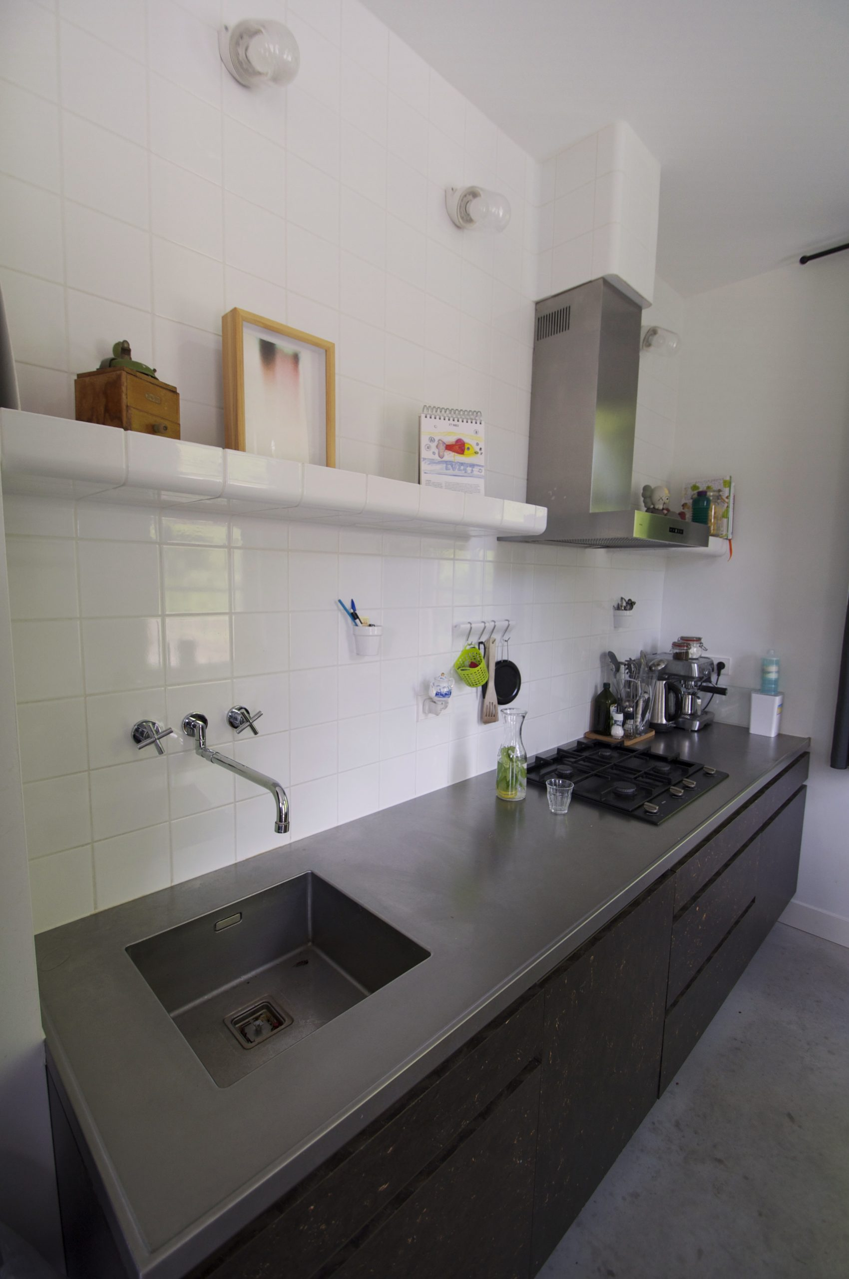 kitchen with tiled wall and shelf