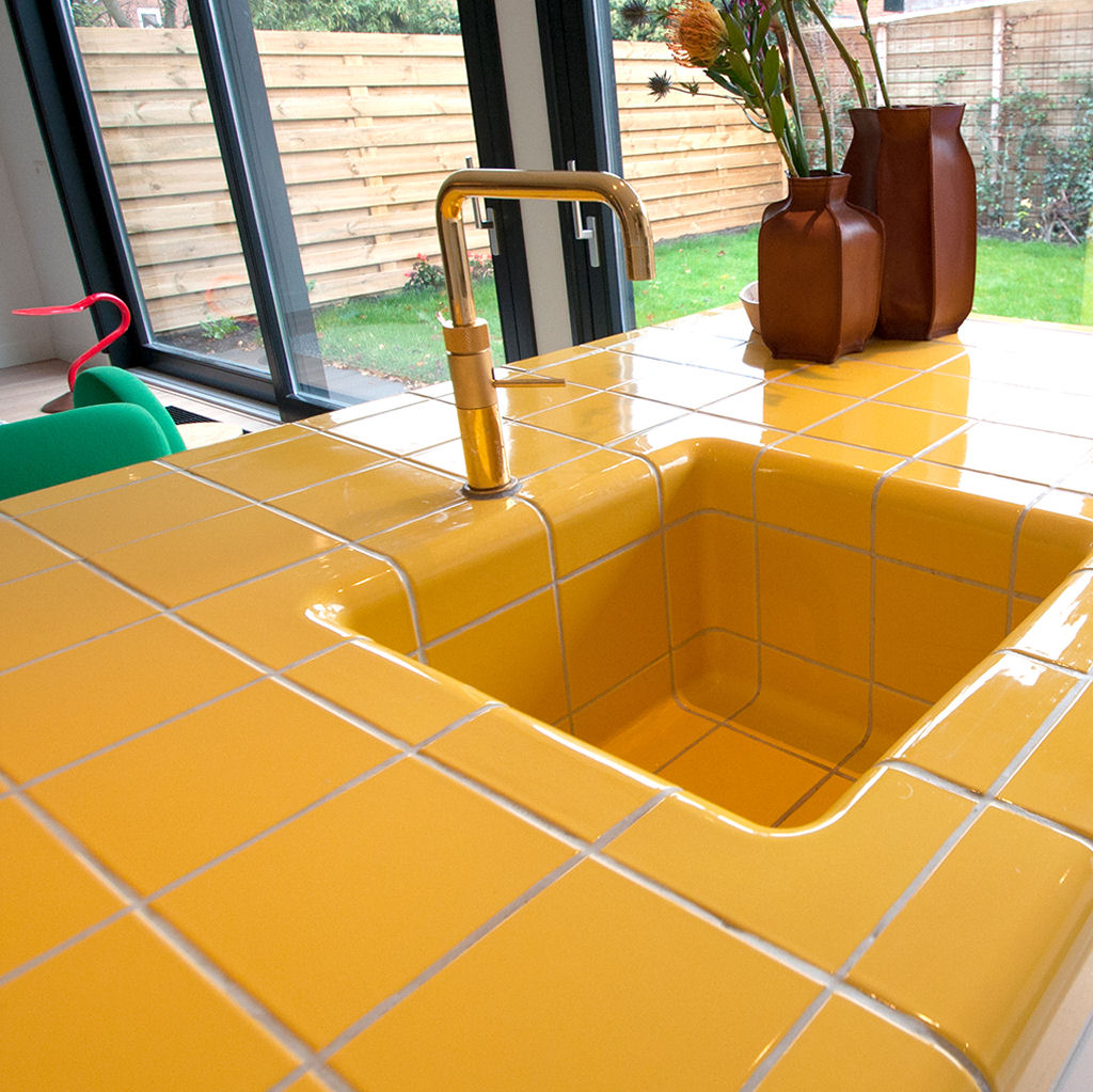 Tiled yellow kitchen with bar