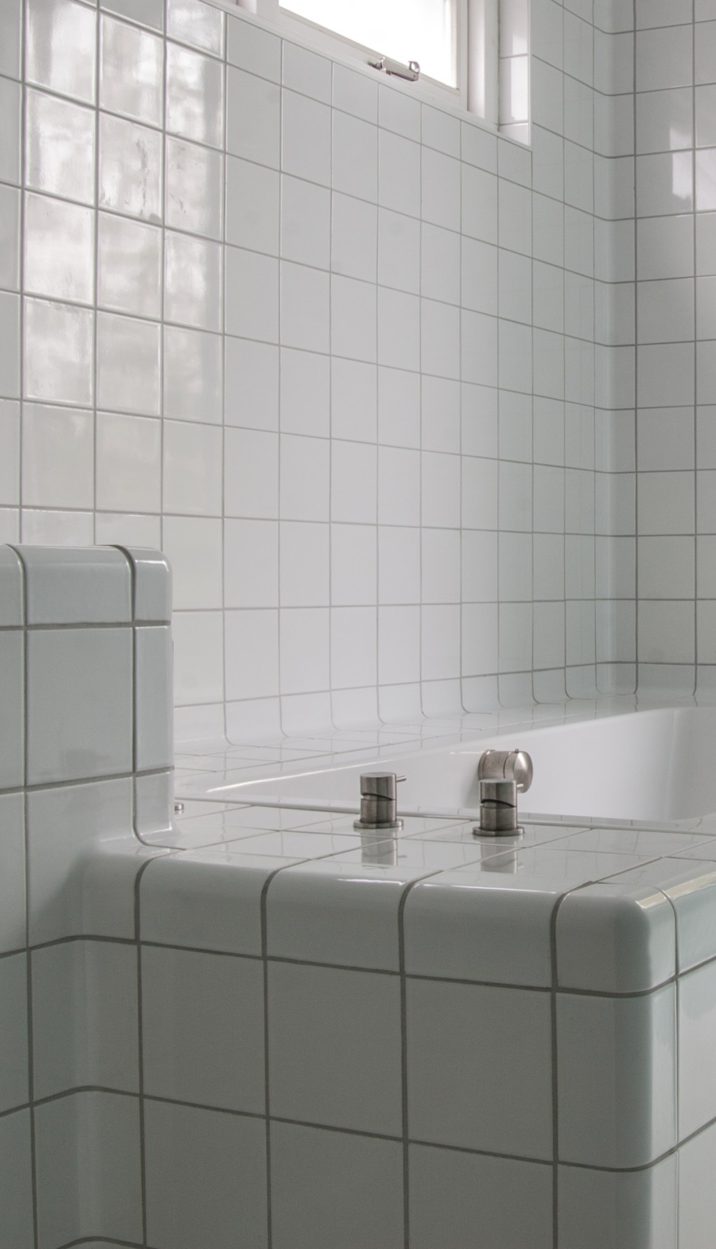 three-dimensional tiles bathtub, modern rounded construction and functional tiles in multiple colors