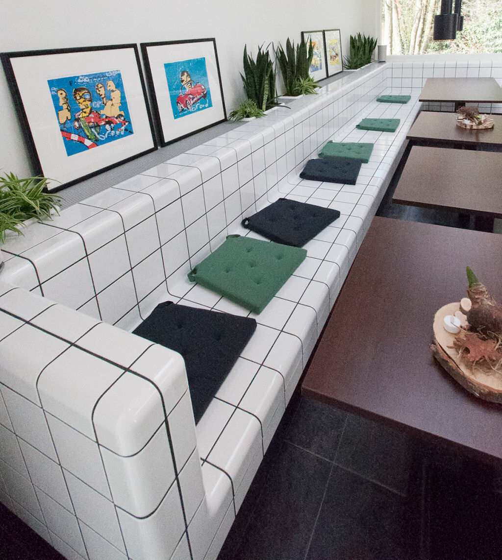 three-dimensional tiled bench, tiles with rounded 3d corners and integrated functions available in 20 colors