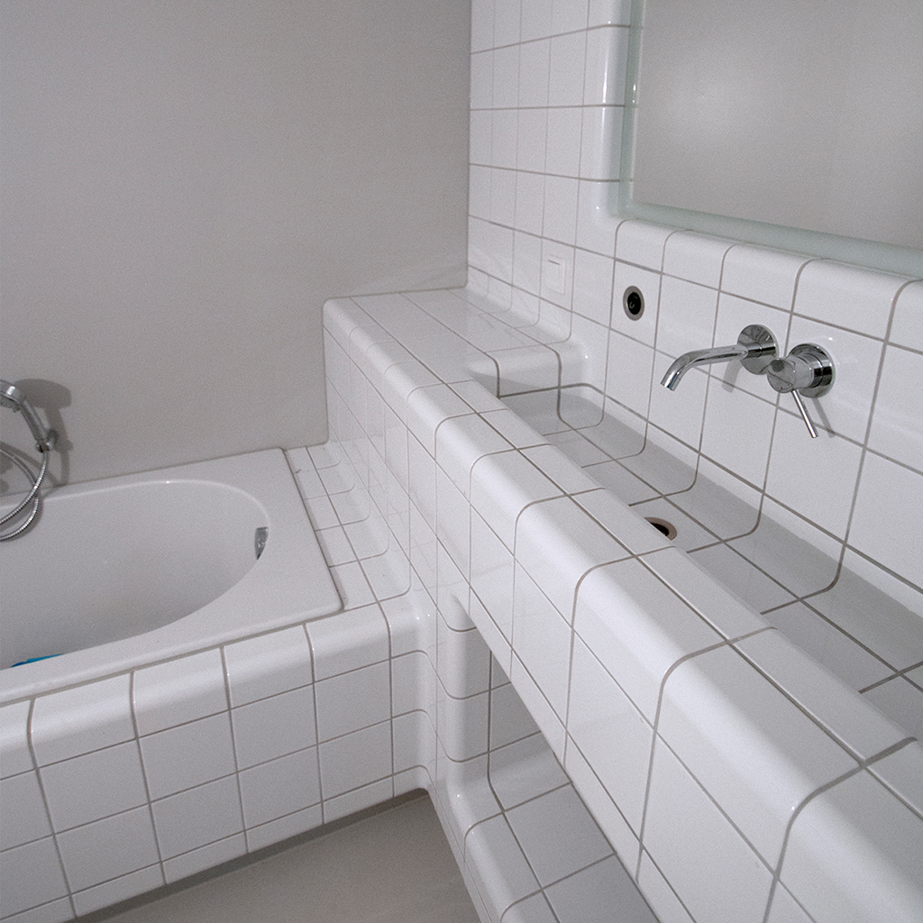 tiling bathroom with rounded tiles