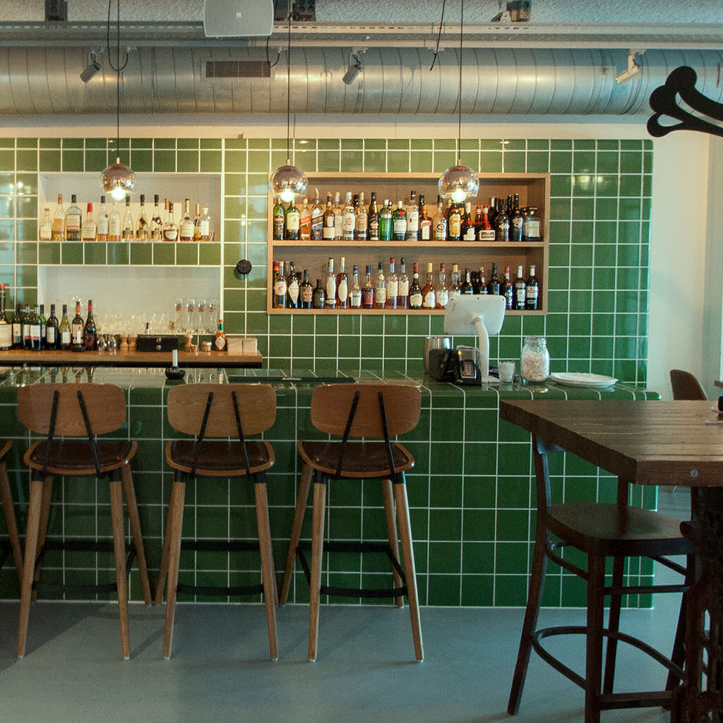 bar with rounded  threedimensional tiles with integrated ventilation, drain, shelves and sink.