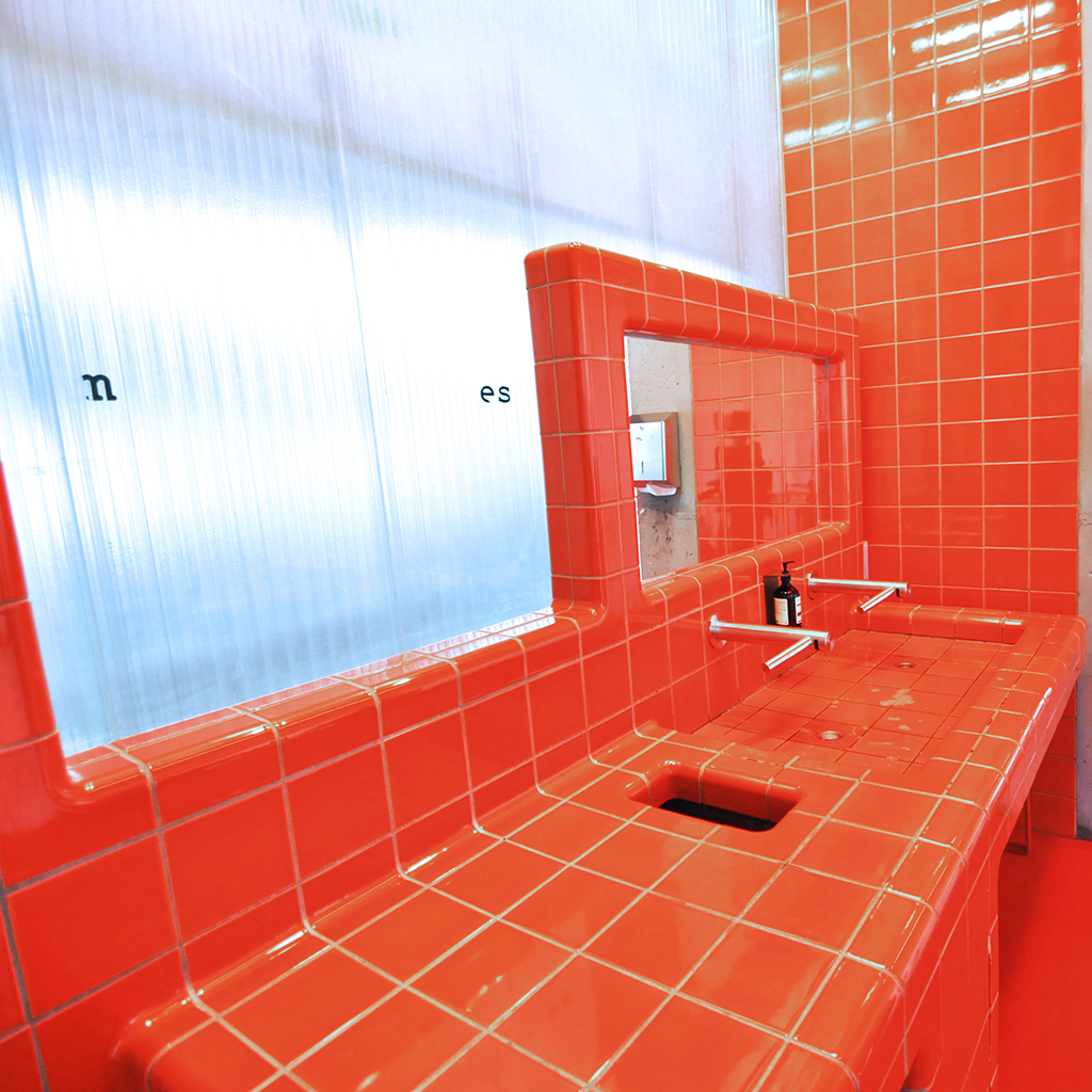 designing bathroom with 3d tiles, integrated tap, sink and mirror