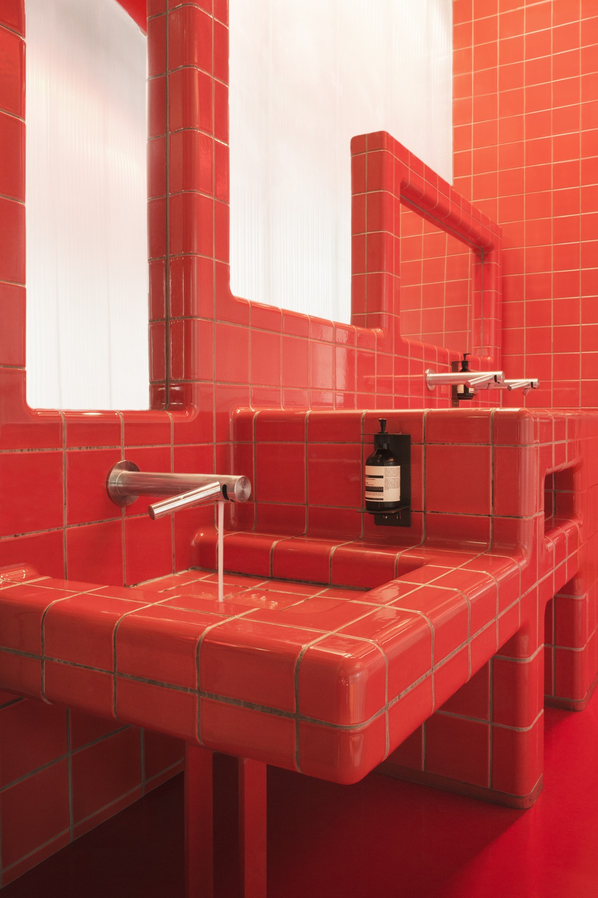 designing bathroom with 3d tiles, with rounded  threedimensional corners and integrated tap, sink, mirror