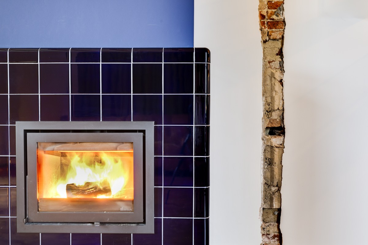3d tiled fireplace, three-dimensional rounded construction and functional tiles in multiple colors