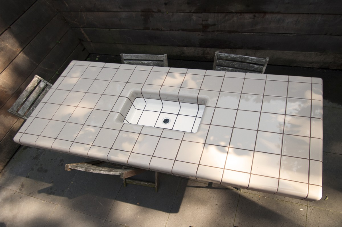 tiled table for chilled drinks with rounded 3d tiles and threedimensional corners