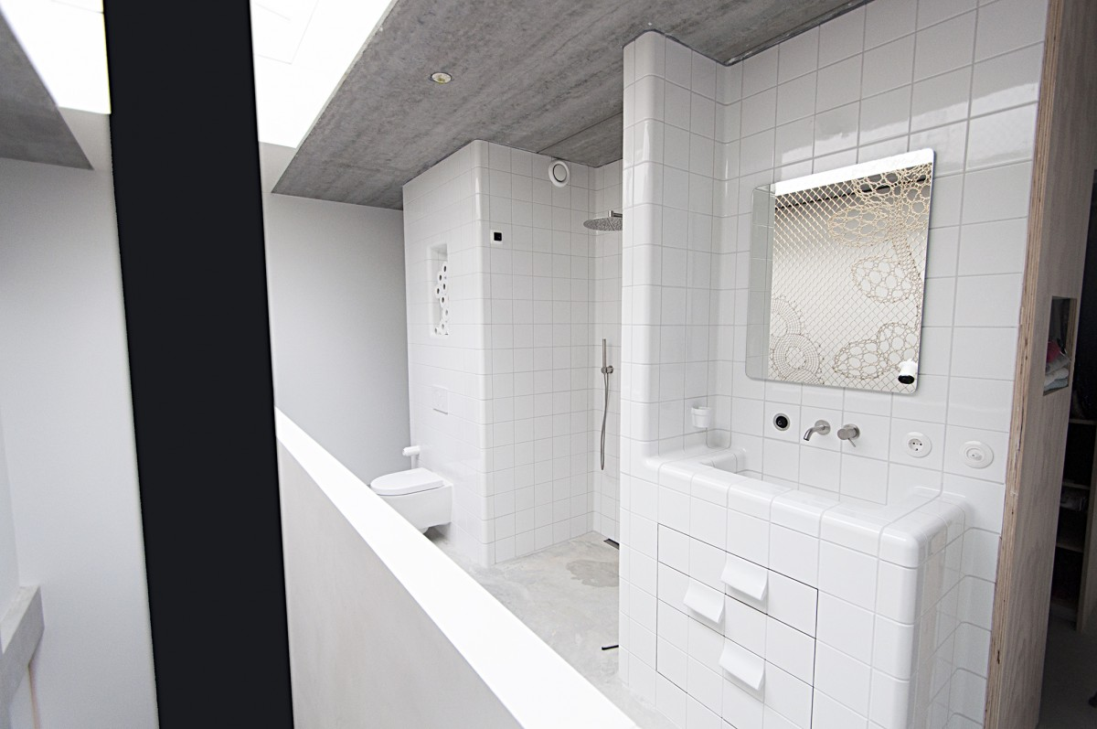 white bathroom design with integrated functions