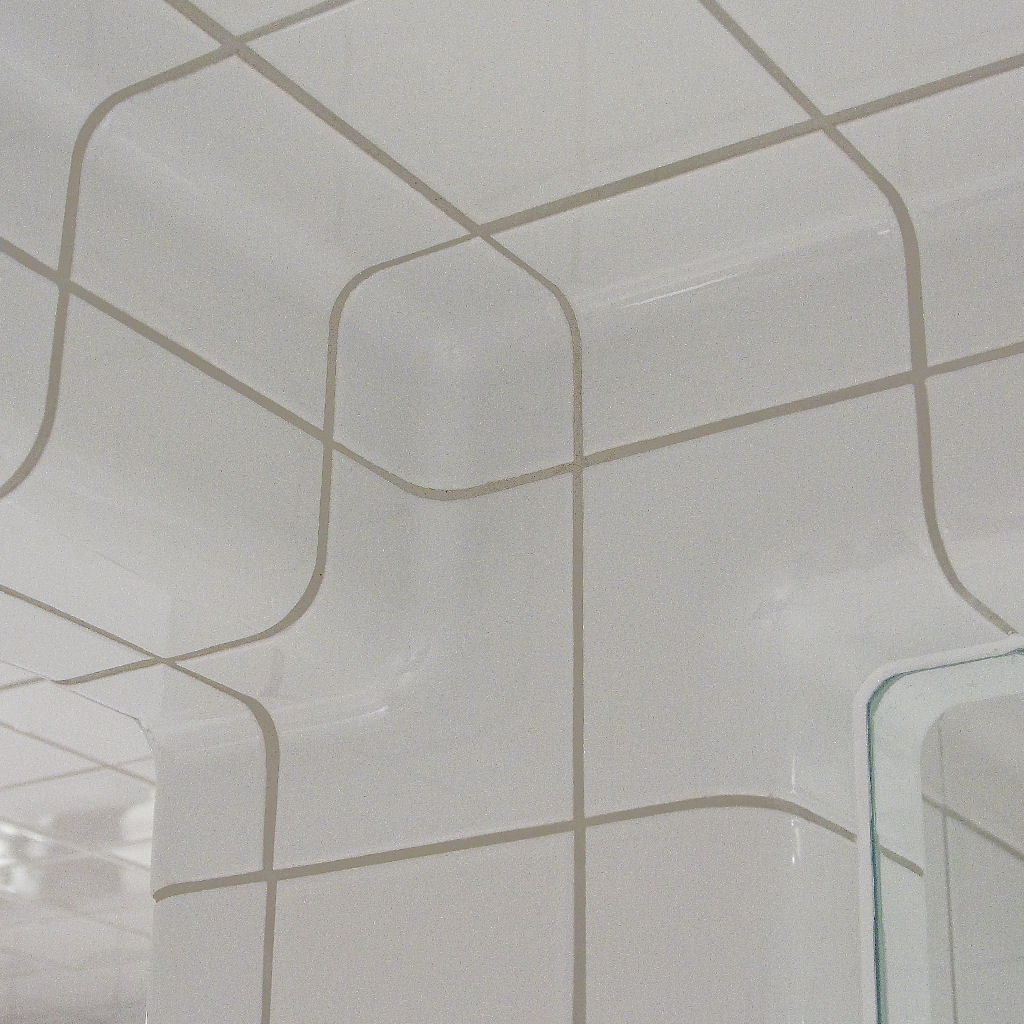 Wall bathroom tiled with rounded tiles