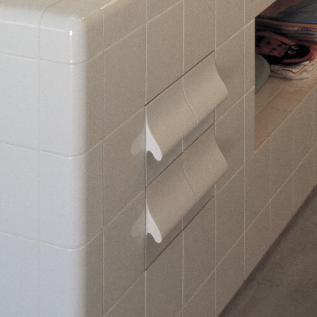 Drawer cabinet with tiled handles, rounded tiles, three-dimensional construction and functional tiles