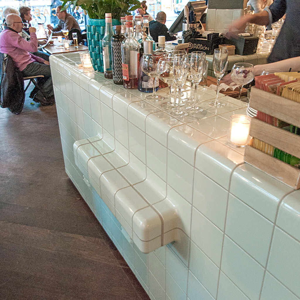 cafe / restaurant with 3d tiles with integrated rounded ventilation and shelves