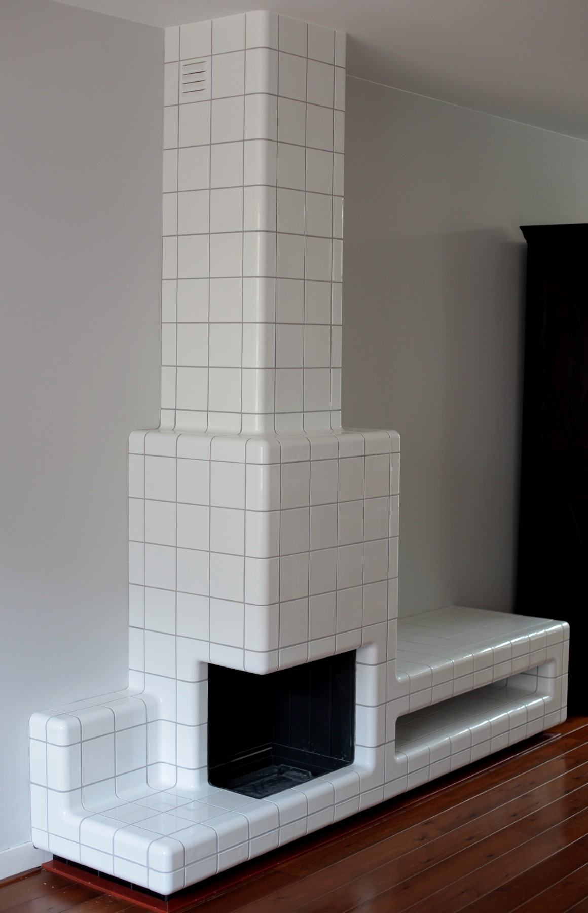 tiled fireplace with rounded 3d tiles, threedimensional corners