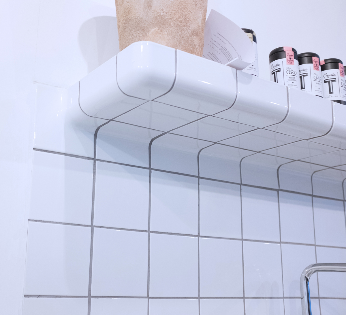 tiled shelf with rounded corners, tiling with three-dimensional construction and functional tiles