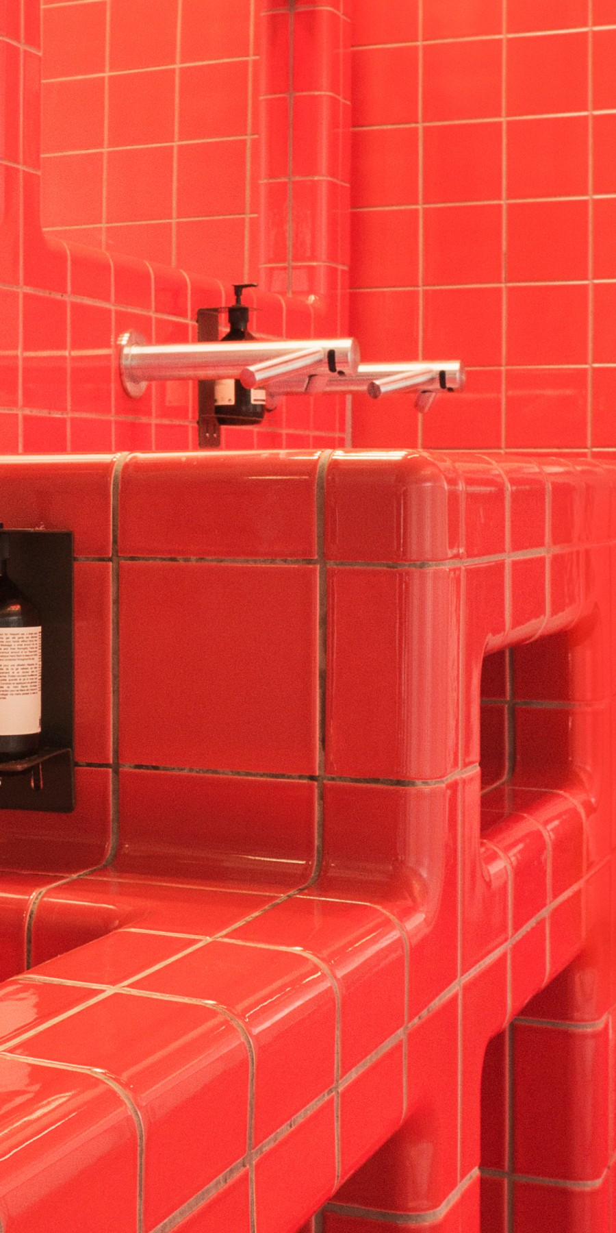 sink with red tiles, rounded  three-dimensional construction and functional tiles